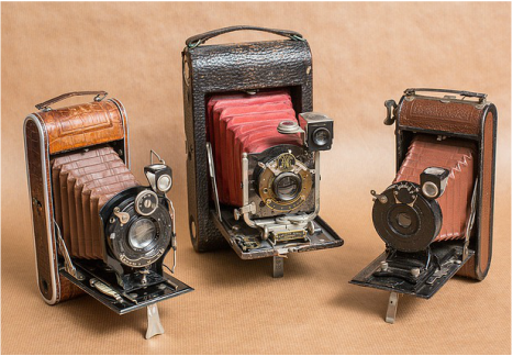 3 vintage cameras, reminiscent of an older patented invention