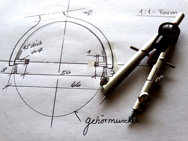 compass and technical drawing for a patent application